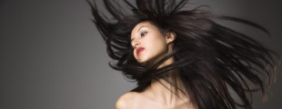 Woman flinging long hair.